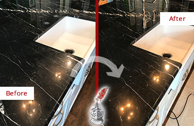 Before and After Picture of a Black Marble Countertop Cleaned and Sealed to Remove Water Marks